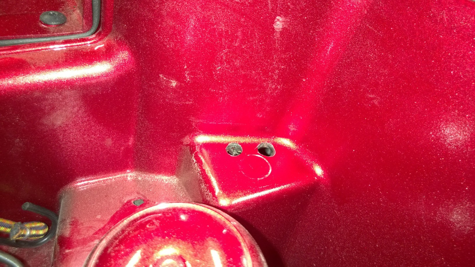 Handy battery terminal access-holes-close-up.jpg