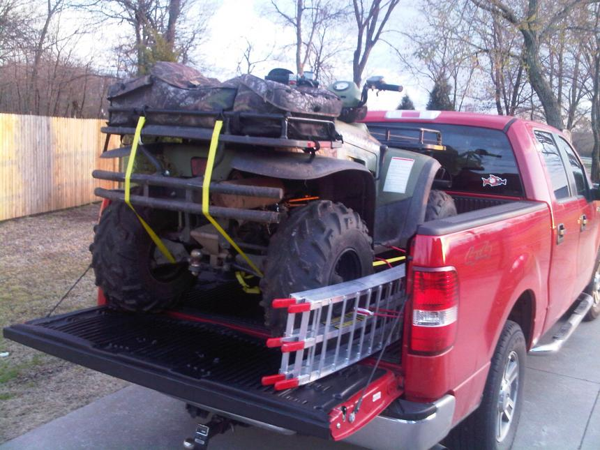 Any pics of Sportsman 400/500 in the back of your trucks ...